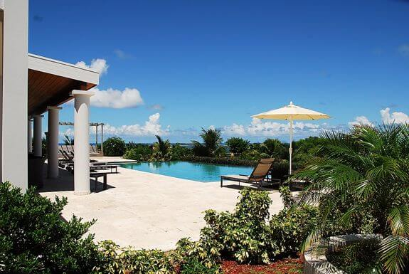 Villa Belle Vue is perched looking over the white sand beach of scenic Orient Bay on the Caribbean Island paradise of French St. Martin.