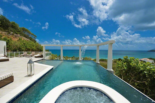 Pool and ocean view at Villa Nid d'Amour