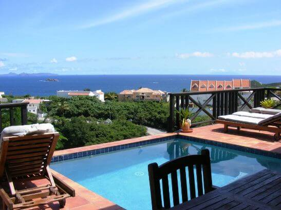 Villa Moondance is a charming two bedroom, two bath villa located on a hillside overlooking the sea at Dawn beach, St Maarten.with beautiful views of Oyster Pond
