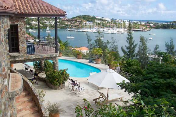 The Stone House at Oyster Pond St Maarten is a hillside retreat with stunning and seductive views of Oyster Pond, the marina, the surrounding ocean and the remarkable hilly skyline of St. Barth's in the distance.