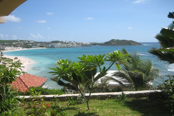 Villa Suzanne a beautiful and spacious 4 bedroom, 4 baths secluded Villa retreat is located hillside on the Dutch side of the island, providing magnificent panoramic views of Dawn Beach and the neighboring island of St Barth