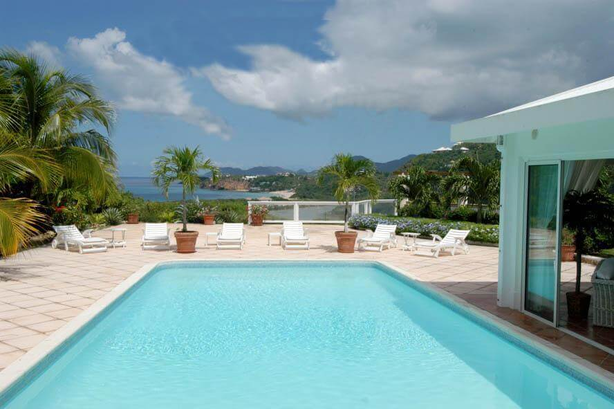 Villa Turquoise, a four bedroom villa is located on a hill overlooking beautiful Baie Rouge Beach with views of the Caribbean Sea.