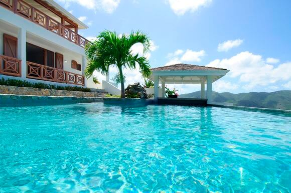 Villa Victoria is a Caribbean style villa located in the gated Oyster Pond Hillside, perched on a hilltop with stunning views of the ocean, surrounding hillsides and Orient Bay.