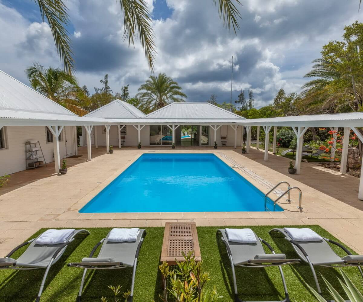 Villa Greystone in the Terres Basse region of French St Martin is a beautiful Caribbean villa rental property with tropical gardens.